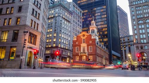 BOSTON, MA, USA – DECEMBER 21, 2016:  Rush hour traffic near the historic Old State House in Boston's Financial District. The Old State House is famous as the location of the Boston Massacre.