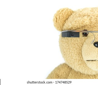 BOSTON, MA, USA - JANUARY 31, 2014: A photo of a bear doll wearing Google Glass. Google Glass is a wearable computer with an optical head-mounted display that is being developed by Google