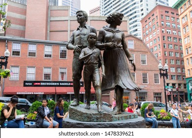 BOSTON, MA, USA - JULY 11, 2019: Irish Famine Memorial in downtown Boston, Massachusetts, the United States. People on the background