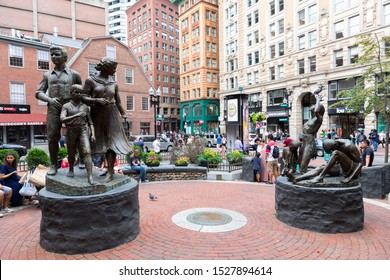 BOSTON, MA, USA - JULY 12, 2019: Irish Famine Memorial in downtown Boston, Massachusetts, the United States. People on the background