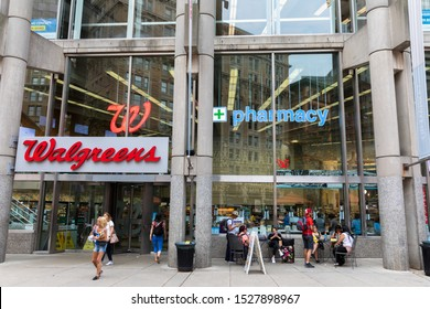 BOSTON, MA, USA - JULY 12, 2019: Walgreens store exterior and signs in Boston. Walgreens is the largest drug retailing chain in the United States.