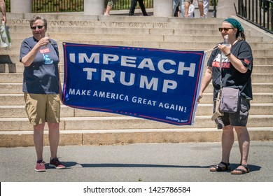 Boston, MA / USA - June 15, 2019: Crowd of citizens protest to impeach President Donald Trump at rally held in front of the state capital building in Boston.