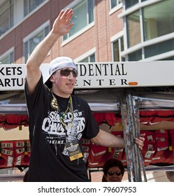 BOSTON, MA, USA - JUNE 18: Brad Marchand celebrates the Stanley cup victory at the Boston Bruins parade after winning the cup for the first time in 39 years, June 18, 2011 in Boston, MA, United States