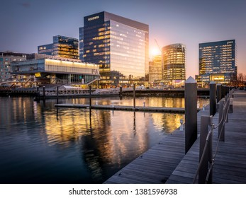 BOSTON, MA, USA - MARCH 15, 2019: The architecture of Boston in Massachusetts, USA at sunset showcasing part of the Boston Harbor and Financial District with the ICA Museum buildings
