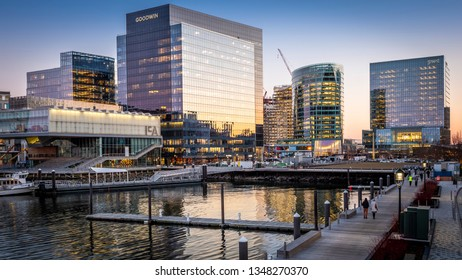 BOSTON, MA, USA - MARCH 24, 2019: The architecture of Boston in Massachusetts, USA at sunset showcasing the Boston Harbor and Financial Distinct.