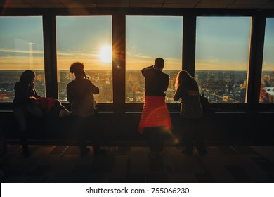 BOSTON MA, USA - November 11, 2017: people take pictures of the sunset from the window. people in Skywalk Observatory on top of the Prudential Tower in Boston