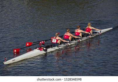 Boston, MA / USA - October 22, 2017: Woman's coxed four boat making their way down the Head of the Charles race course