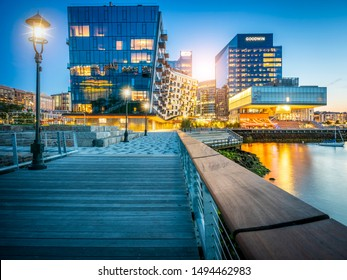 BOSTON, MA, USA - SEPTEMBER 1, 2019: The contemporary architecture of Boston in Massachusetts, USA at sunset showcasing its skyline at Seaport Boulevard.