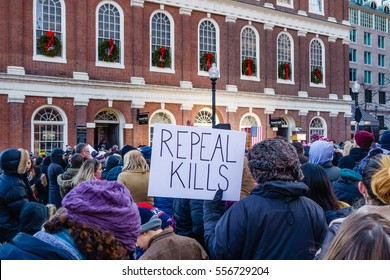 Boston, MA, USA-January 15, 2017. Protester with sign at â?� Our First Stand:  Save Health Care Rallyâ?� where Elizabeth Warren spoke to audience in front of historic Fanueil Hall.