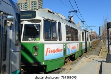 BOSTON - MAR. 29, 2015: Boston Metro MBTA Kinki Sharyo Type 7 Green Line at Boston University, Boston, Massachusetts, USA.