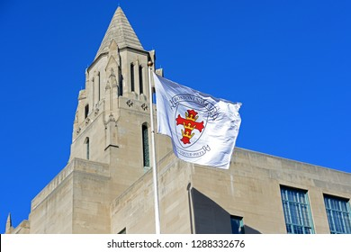BOSTON - MAR. 29, 2015: Boston University flag in front of College of Arts and Sciences in Boston University, Boston, Massachusetts, USA.