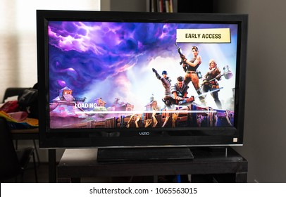 BOSTON, MASSACHUSETTS - APRIL 10, 2018: Fortnite video game early access screen. Fortnite is a popular video game developed by Epic Games and People Can Fly for Consoles, PC/Mac, and Mobile Devices.