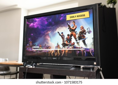 BOSTON, MASSACHUSETTS - APRIL 12, 2018: Fortnite video game early access screen on console. Fortnite is a popular video game developed by Epic Games and People Can Fly.