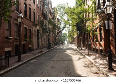 BOSTON, MASSACHUSETTS - AUGUST 17, 2018: A street in Beacon Hill, Boston, one of the most expensive and historic neighborhoods in the city.