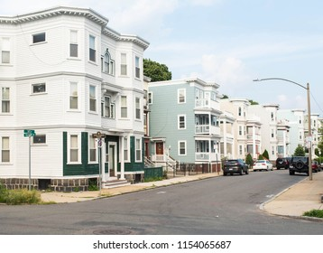 BOSTON, MASSACHUSETTS - AUGUST 4, 2018: Street view in Dorchester of multi-family properties and various housing for rent.