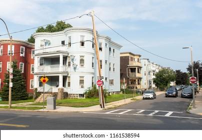 BOSTON, MASSACHUSETTS - AUGUST 4, 2018: Street view in Savin Hill, Boston of multi-family properties and various housing for rent.
