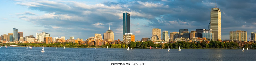 Boston Massachusetts Back Bay District with dark clouds behind and sailboats on the Charles River