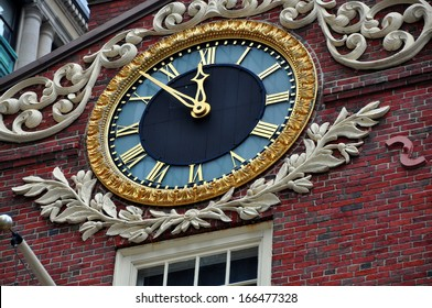 BOSTON, MASSACHUSETTS:   A handsome clock adorns the facade of the historic 1713 Old State House at the corner of State and Washington Streets is a landmark site on the Freedom Trail