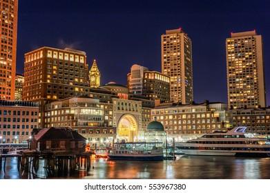 BOSTON, MASSACHUSETTS - JANUARY 03, 2014: Boston Cityscape with River Bridge. Long Exposure Night Photography.