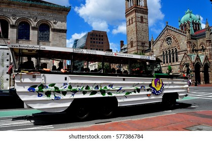 Boston, Massachusetts - July 14, 2013: A Boston Duck Tours bus/boat filled with tourists in Copley Square