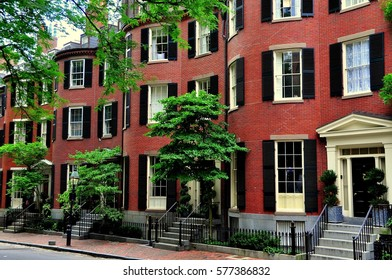 Boston, Massachusetts - July 14, 2013:  19th century brick homes with front curved bays  Beacon Hill's historic Louisburg Square