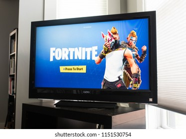 BOSTON, MASSACHUSETTS - JULY 22, 2018: Fortnite video game start screen. Fortnite is a popular video game developed by Epic Games and People Can Fly for Consoles, PC/Mac, Nintendo, and Mobile Devices.