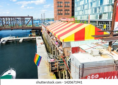 BOSTON, MASSACHUSETTS - JUNE 2, 2019: Famous Barking Crab restaurant on the Boston Seaport with pride flags up to celebrate LGBTQ+ rights during the month of June.