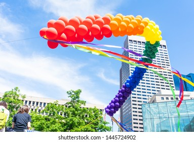 BOSTON, MASSACHUSETTS - JUNE 8, 2019: Gay Pride Parade in Boston June 2019, rainbow balloons to celebrate lesbian, gay, bisexual, transgender, and others human rights