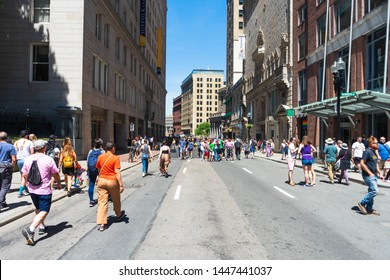 BOSTON, MASSACHUSETTS - JUNE 8, 2019: People walking to watch the Boston Gay Pride Parade in Summer 2019.