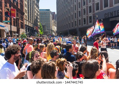 BOSTON, MASSACHUSETTS - JUNE 8, 2019: Crowds watching the end of the Boston Pride Parade 2019