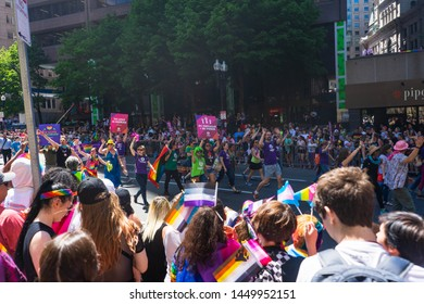 BOSTON, MASSACHUSETTS - JUNE 8, 2019: Crowded festival and celebrations at Boston Pride Parade 2019 with gay pride flags and transgender flags