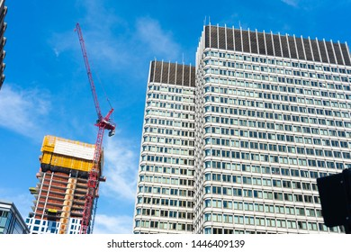 BOSTON, MASSACHUSETTS - JUNE 9, 2019: Construction crane for new skyscrapers and office buildings near the Financial District in Boston, MA.