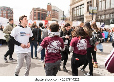 BOSTON, MASSACHUSETTS - MARCH 24, 2018: Marjory Stoneman Douglas High School students protesting and marching for tighter gun control in unity with other students from Boston and across the country.