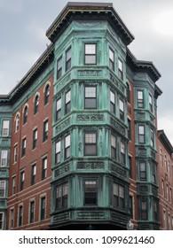 Boston, Massachusetts - May 3, 2018: Copper Tripartite, Bay Windows in the North End neighborhood of Boston, Massachusetts.