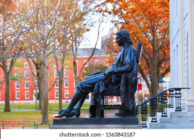 Boston Massachusetts - November 10, 2019: The Statue of John Harvard on campus of Harvard University at sunrise. Harvard University is a private Ivy League research university in Cambridge, MA.