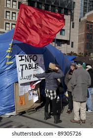 BOSTON, MASSACHUSETTS - NOVEMBER 19: The Occupy Boston camp with its signs, banners and red flags of socialism in Boston, Massachusetts, USA on November 19, 2011.
