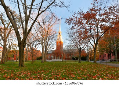 Boston Massachusetts - November 9, 2019: Memorial Church and Harvard Yard on campus of Harvard University at sunset. Harvard University is a private Ivy League research university in Cambridge, MA.