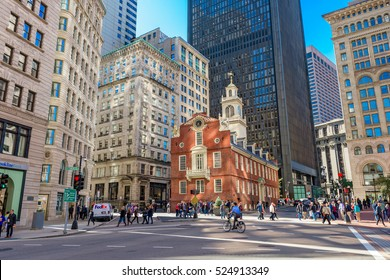 BOSTON, MASSACHUSETTS - OCTOBER 14, 2016: Pedestrians cross at the Old State House in Boston.