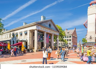 BOSTON, MASSACHUSETTS - September 18, 2014: Quincy Market is an historic marketplace near Faneuil Hall in downtown Boston. Besides the main iconic building, there is also a North and South market.