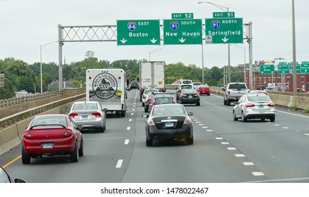 Boston, Massachusetts- September 2017: Cars traveling on the Interstate with directional signs to Boston, Springfield and New Haven.