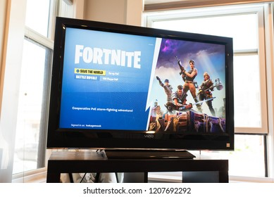 BOSTON, MASSACHUSETTS - SEPTEMBER 29, 2018: Fortnite start screen for the popular Battle Royale video game developed by Epic Games for console, pc, mobile, and more.