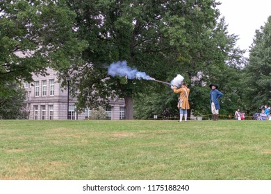 BOSTON, MASSACHUSETTS - SEPTEMBER 8, 2018: A revolutionary war reenactor fires a flintlock musket during a demonstration at the Bunker Hill monument.