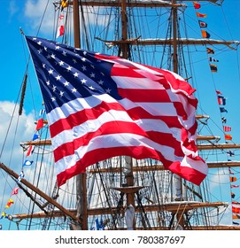 Boston, Massachusetts / USA - 6/20/2017:  This large American flag  Caught a stiff breeze at the Boston Sails event.