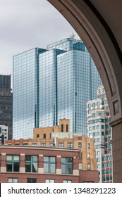 Boston, Massachusetts, USA - April 13, 2008: Layers of buildings in Boston financial district from beneath arch at Rowes Wharf