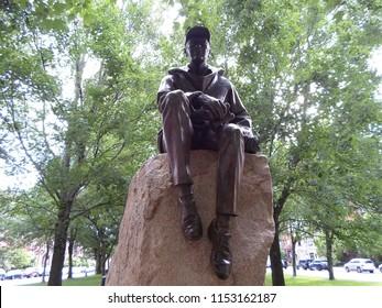 Boston, Massachusetts / USA - August 9 2018: Bronze and granite sculpture of Harvard professor Samuel Eliot Morison, located on Commonwealth Avenue Mall