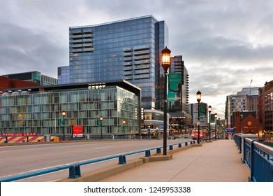 Boston, Massachusetts, USA - December 1, 2018: Boston Financial district before sunrise. Photo shows Seaport Blvd with street lights.