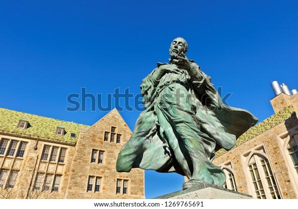 Boston Massachusetts USA - December 25. 2018: Sculpture of St. Ignatius of Loyola, founder of the Jesuit order, on the campus of Boston College in Chestnut Hill, Massachusetts.