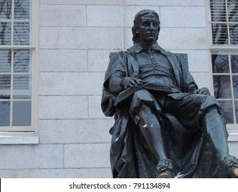 Boston, Massachusetts / USA - December 29 2017: John Harvard Statue at the Harvard University in Boston Massachusetts