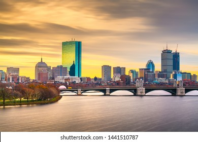 Boston, Massachusetts, USA downtown cityscape from across the Charles River at dawn.