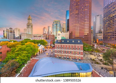 Boston, Massachusetts, USA downtown markets and cityscape at twilight.